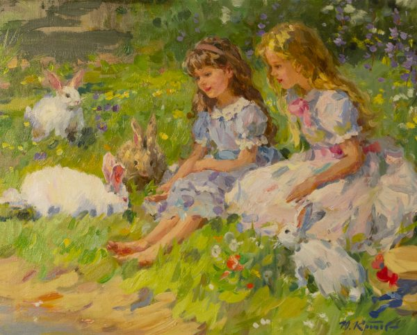 Two Young Girls sitting with Rabbits